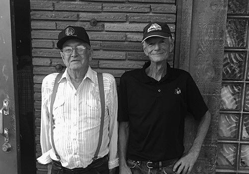 Image of William Glasser and Larry Johnston outside a drinking establishment.